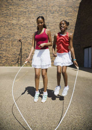 Girls jumping rope together photo