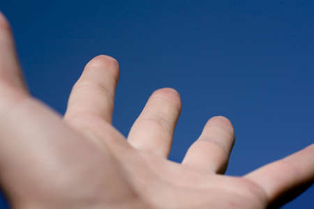 curtis: Hand reaching to the sky Stock Photo