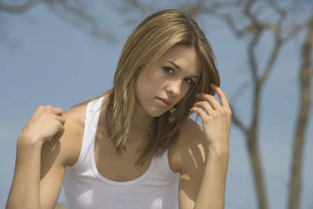 eyecontact: Woman sitting outside