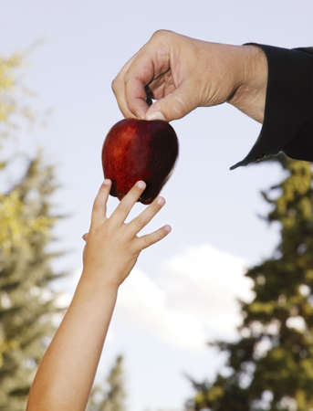 deceitful: Father passing fruit to child