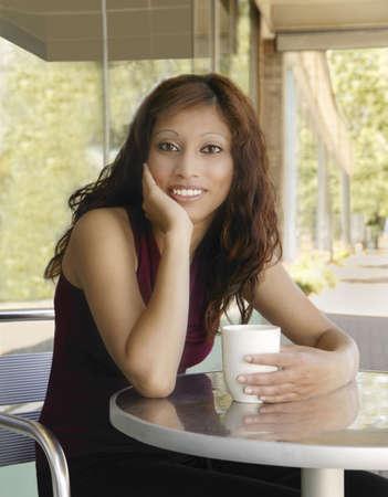 eyecontact: Woman having a coffee