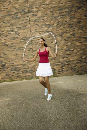 skipping: Young woman skipping