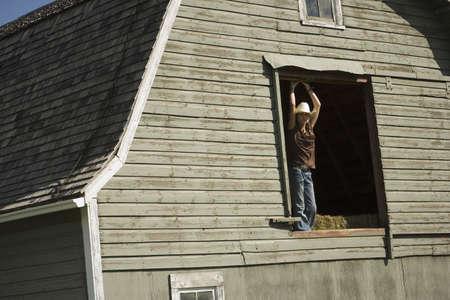 Young woman in barn loft photo