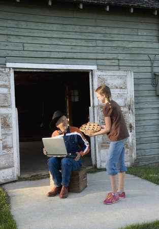 intergenerational: Granddaughter bringing pie to her grandfather