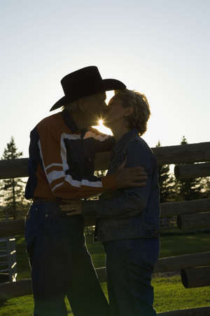 Couple kissing at ranch photo