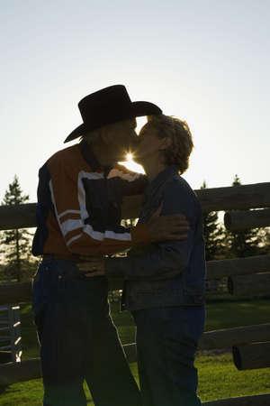 Couple kissing at ranch photo