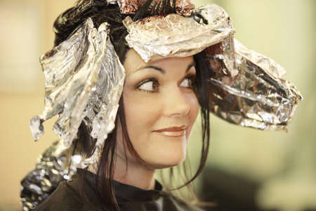 Woman having her hair dyed photo