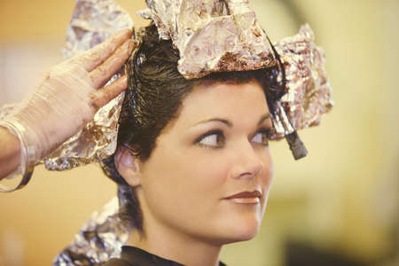 Woman having her hair dyed Stock Photo