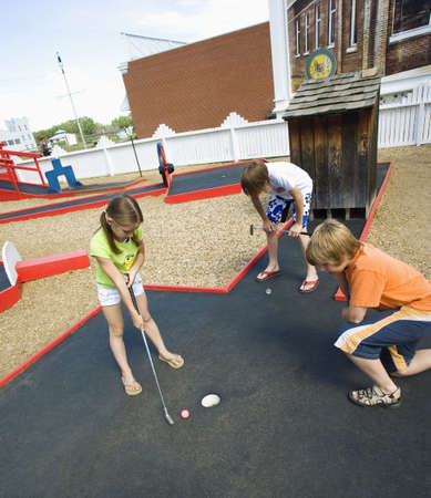 preteen girls: Children playing mini golf
