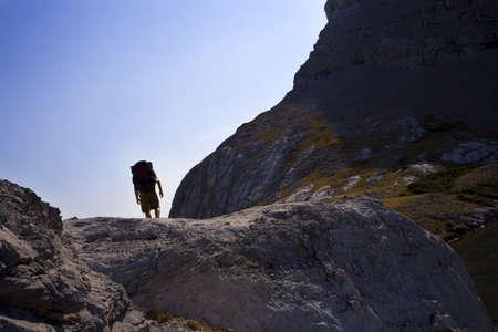 curtis: Man hiking in mountains