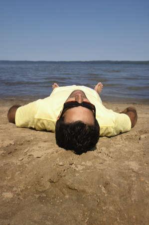 glubish: Man lying on beach