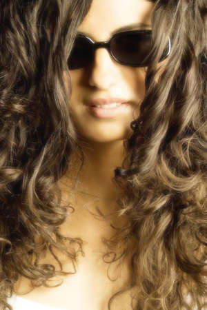 curls: Young woman with curls and glasses