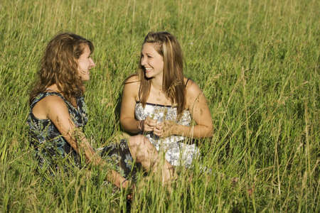 Two young women talking in field Stock Photo - 7191105