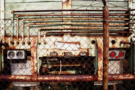 chainlinks: Old rusty truck behind fence Stock Photo