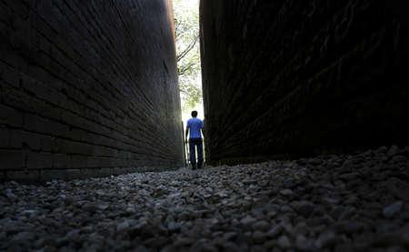destined: Man walking between buildings
