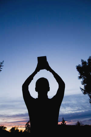 Man with Bible raised to the heavens Stock Photo - 7192001