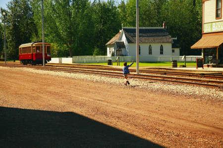 Boy waving at trolley photo