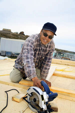 nations: Inuit construction worker Stock Photo