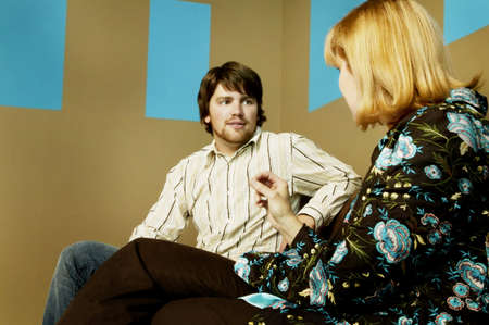 Man and woman talking photo