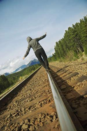 線路の上を歩いて女性 写真素材