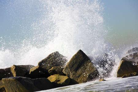 ocean waves: Water crashing over rocks