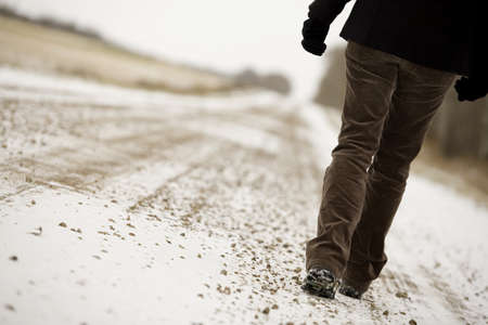 leisurely: Person walking along road