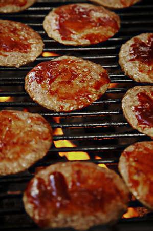 barbecuing: Barbecuing hamburgers Stock Photo