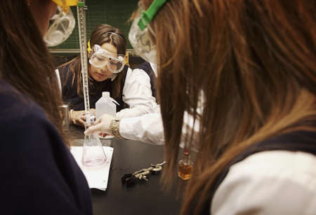 private schools: Students working in a science lab Stock Photo
