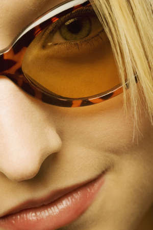 Extreme close up of woman wearing sunglasses photo