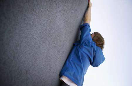 clinging: Man hanging on