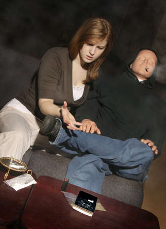 interventions: Pleading with a drug addict Stock Photo
