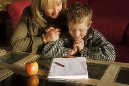 Mother and son praying together photo