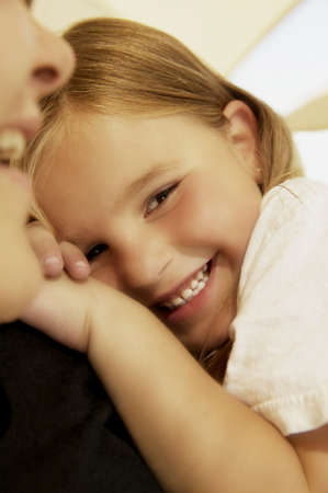 Girl resting on her mother's shoulder Stock Photo - 7195765