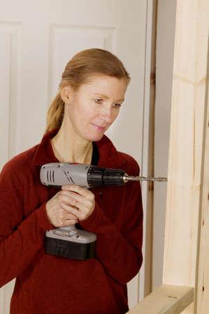 30 something: Woman drilling