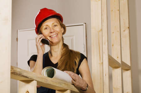 50 something fifty something: Tradeswoman at work Stock Photo