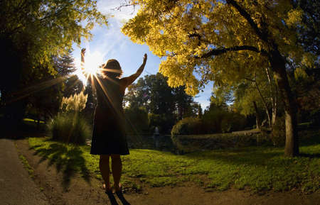 worshipping: Woman praying outdoors Stock Photo