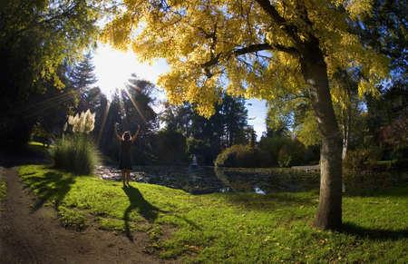 intercessory prayer: Woman praying outdoors Stock Photo