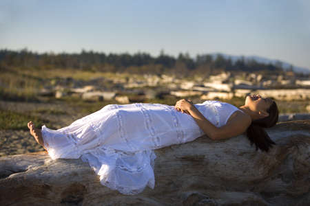 A Filipino woman wearing a white dress on the beach photo