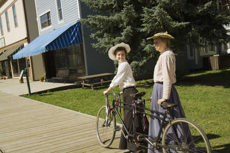 two and a half: Two women with a vintage bicycle built for two