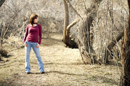 wooded: Young woman posing in a wooded area Stock Photo