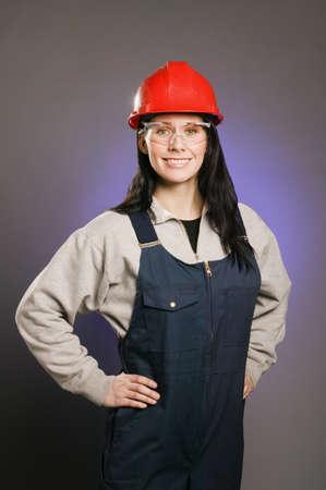 tradeswomen: Tradeswoman in coveralls