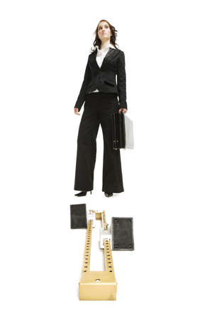 Businesswoman standing behind a starting block