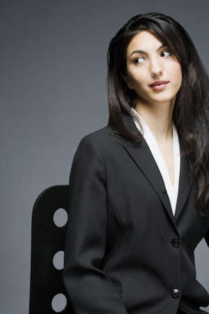 Businesswoman sitting on a chair photo