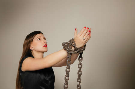 Woman wrapped in a chain photo
