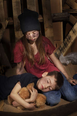 homeless man: Impoverished boy and girl Stock Photo