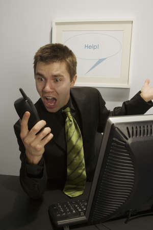 Businessman screaming into a phone Stock Photo - 7196927