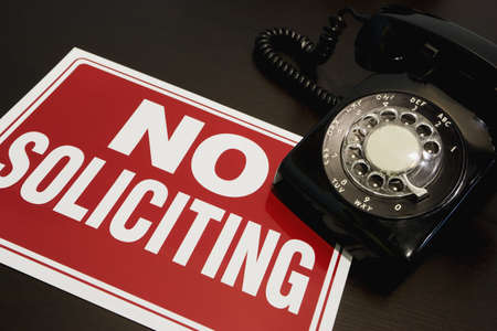 solicitors: No soliciting sign with a telephone Stock Photo