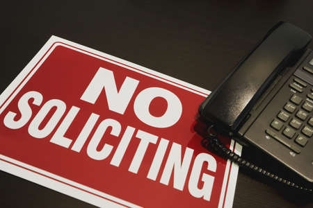 soliciting: No soliciting sign with a telephone Stock Photo