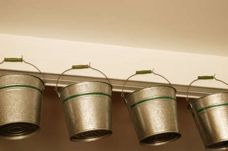 Low angle view of hanging buckets