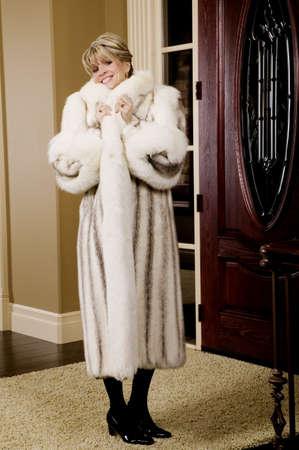 Woman wearing a fur coat photo